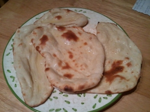 3 pieces of naan, all shiny from the melted ghee