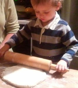 This is a freshly rested disk of dough. It's such a lovely, stretchy dough that even I could roll it fairly easily (though Mama did help).