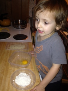 The flour helps the egg stick to the rice ball, and the egg helps the bread crumbs stay put.